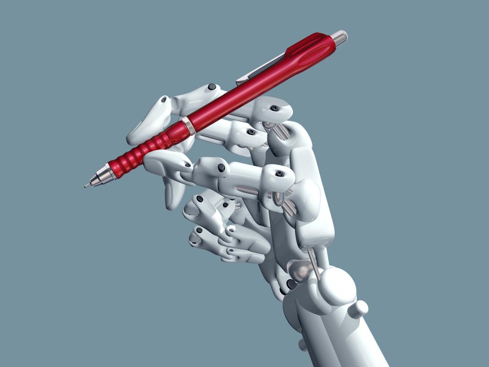ボールペンを持つロボットの手