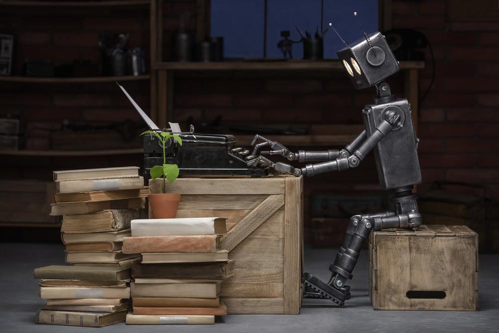 タイプライターで何かを執筆しているロボット